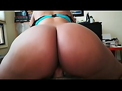 Reverse cowgirl with ebony woman