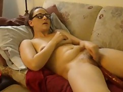Woman masturating and fucking with a dildo