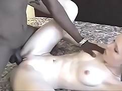 Young white wife with black lover in hotel