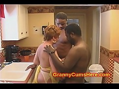 Granny slut fucked by a big black cock in the kitchen