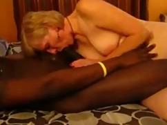 Mature woman blows huge black cock