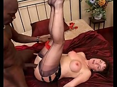 Milf in black seamed stockings sucks and fucks a big black cock