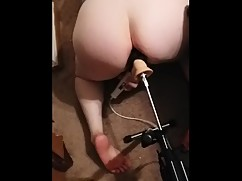 Wife gets cum while being fucked by a big black cock fixation machine